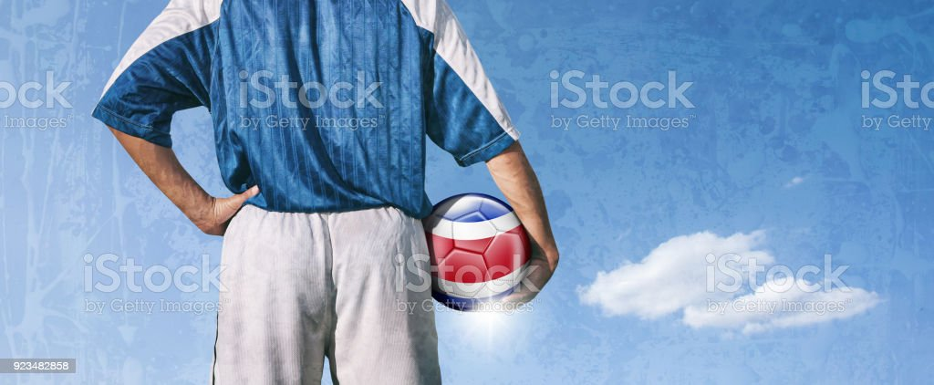 Costa Rica soccer player holding ball with flag stock photo