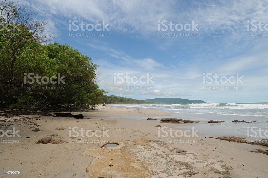 Costa Rica Tropical Beach, Ocean and Shoreline Photo of the beach and coastline taken in Santa Teresa and Mal Pais area of Costa Rica.  The beach is on the Pacific side of the country. Bay of Water Stock Photo