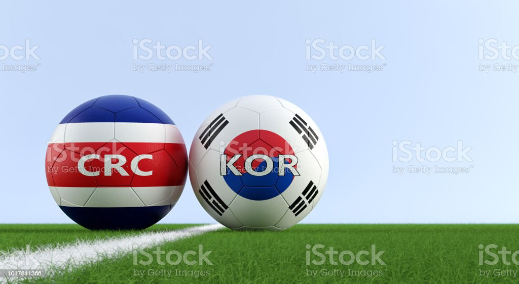 Costa Rica vs. South Korea Soccer Match - Soccer balls in Costa Rica and South Korea national colors on a soccer field. Copy space on the right side - 3D Rendering stock photo