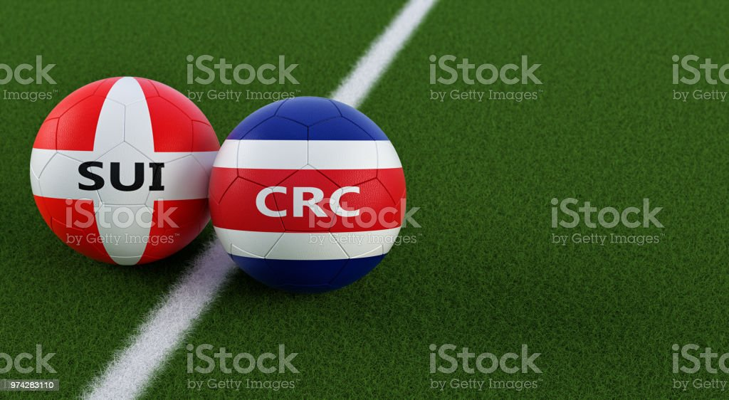 Costa Rica vs. Switzerland Soccer Match - Soccer balls in Costa Rica and Swiss national colors on a soccer field. Copy space on the right side - 3D Rendering stock photo