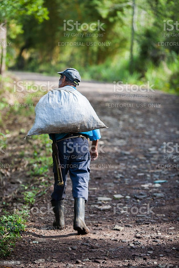 Costa Rican local many carrying sack royalty-free stock photo