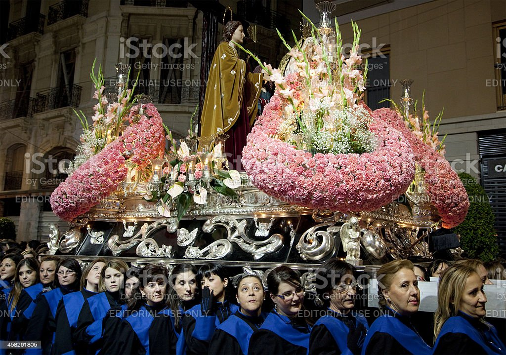 Costaleras carrying a trono during the Semana Santa Processions, stock photo