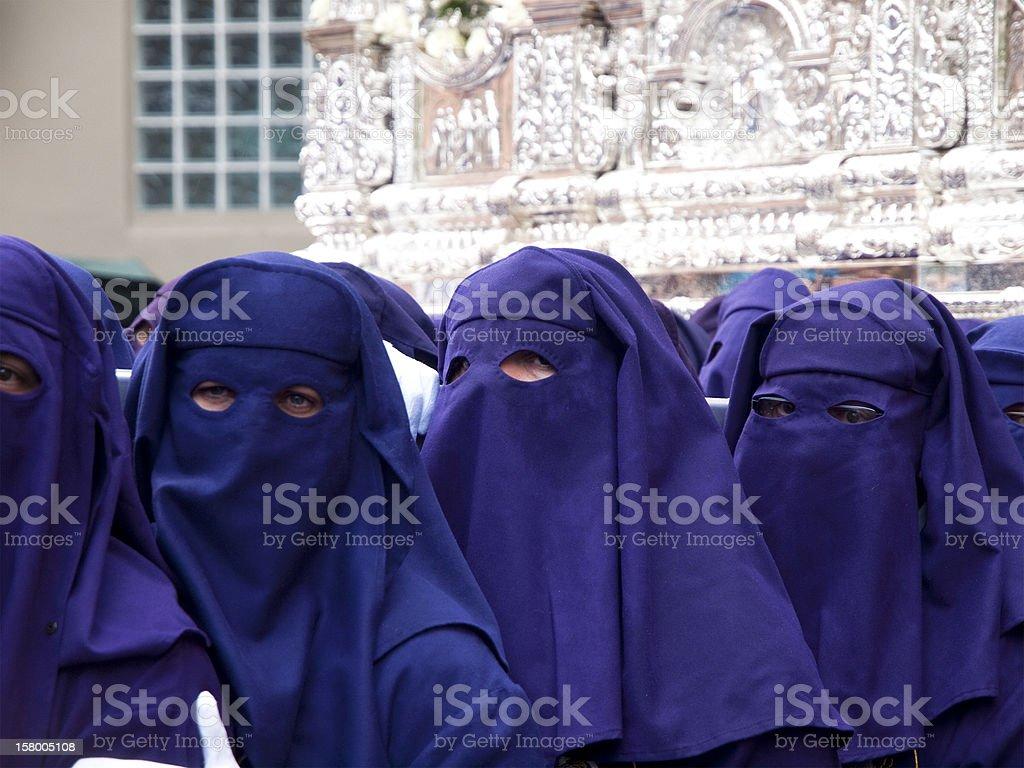 Costaleros bearing a Trono during Semana Santa in Malaga, Spain royalty-free stock photo