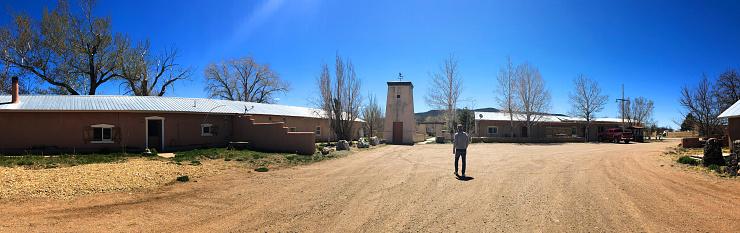 Costilla, NM: A man walks on the old Plaza de Arriba in Costilla, NM, an adobe village in northern New Mexico, near the Colorado border.