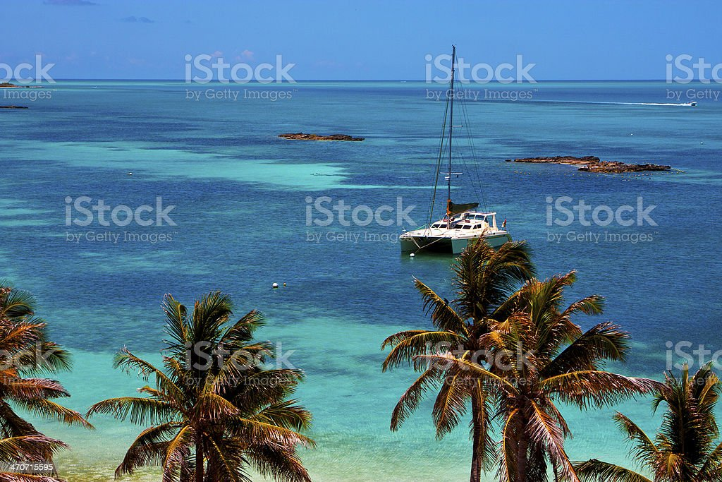 costline boat catamaran in the  blue lagoon relax    contoy  mex stock photo