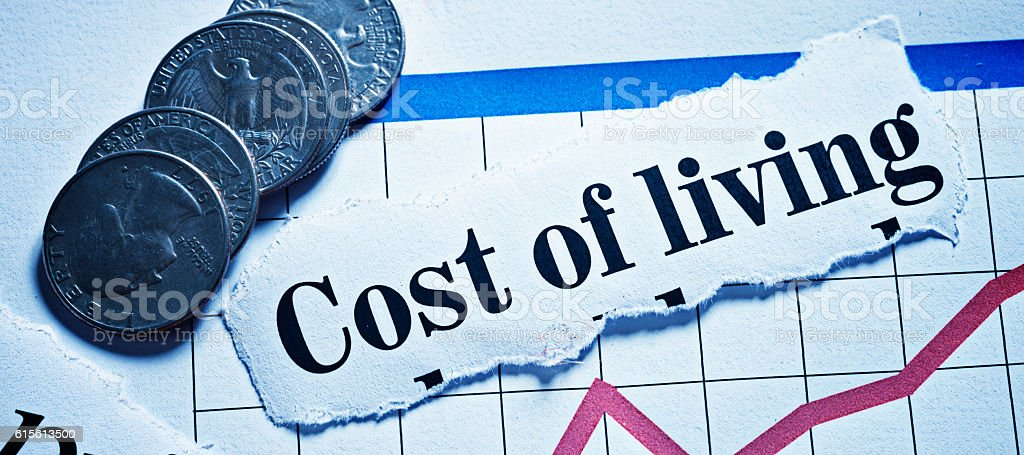 Cost-of-living headline with steeply rising graph and small change stock photo