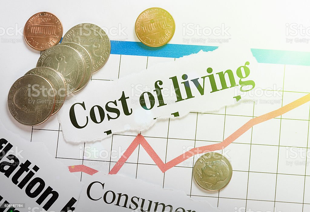 Cost-of-living headlines with rising graph and US coins stock photo