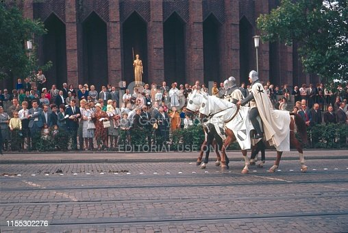 Dusseldorf, North Rhine Westphalia, Germany, 1968. Costume parade with Crusader costumes on horses in Dusseldorf. Also: spectators at the roadside.