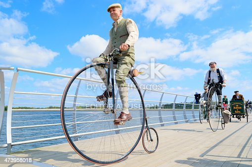 Solvesborg, Sweden - May 16, 2015: International Veteran Cycle Association (IVCA) 35th rally. Costume ride through public streets in town. Senior man on penny-farthing.
