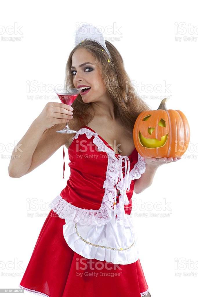 Costume series: sexy maid holding martini glass and halloween pumpkin. royalty-free stock photo