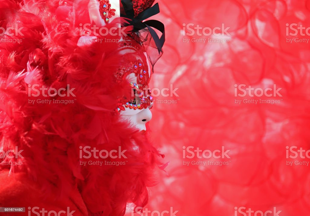 costume with white mask and background all red stock photo