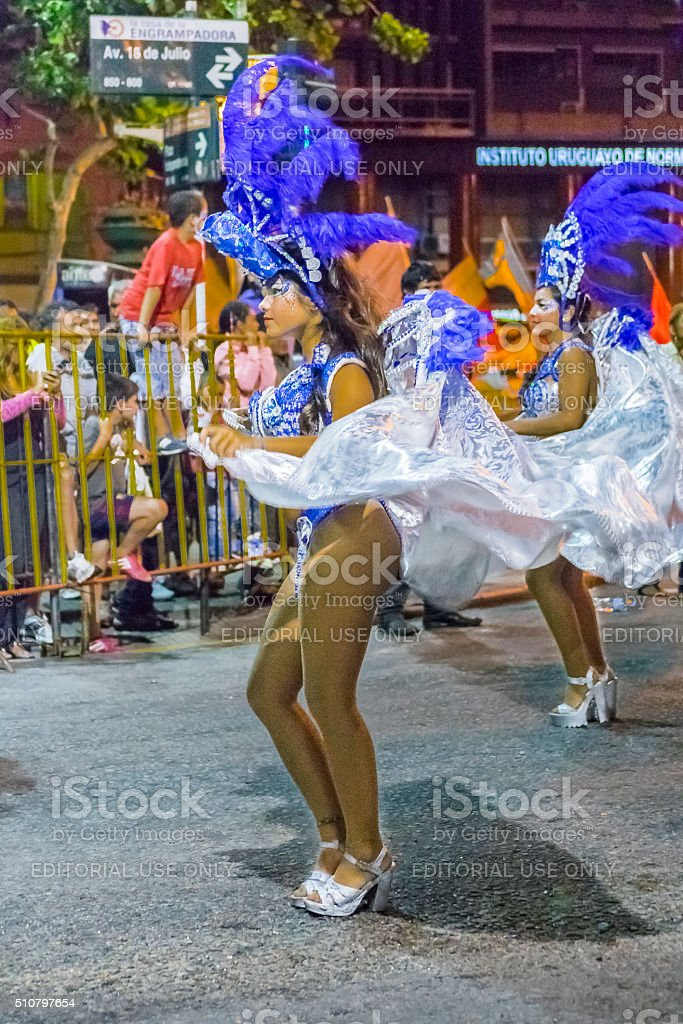 Costumed Attractive Women Dancer at Carnival Parade of Uruguay stock photo