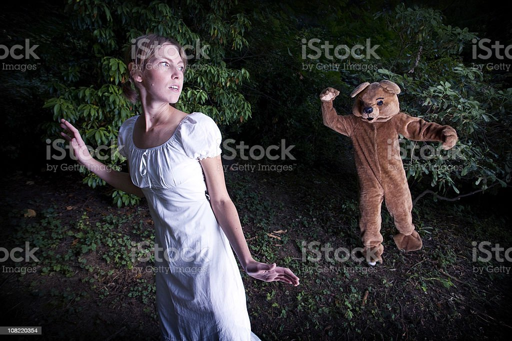 Costumed Bear Chasing A Young Woman stock photo