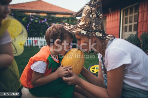 istock Costumed boy and his mom holding a pumpkin 607738032