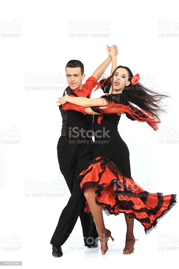 Costumed couple performing flamboyant ballroom dance stock photo