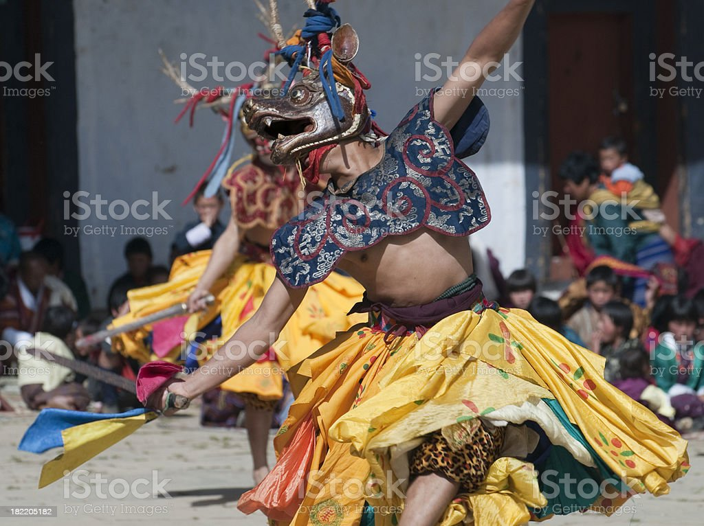 Costumed Dancer in Traditional Bhutan Festival stock photo