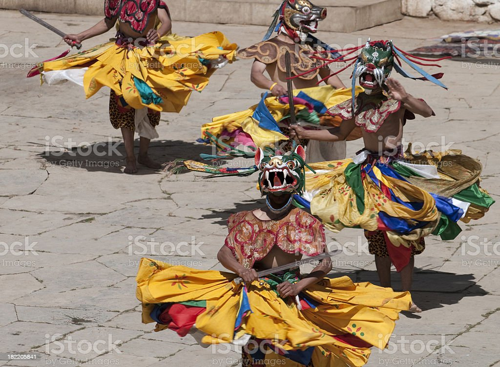 Costumed Dancers in Traditional Bhutan Festival stock photo