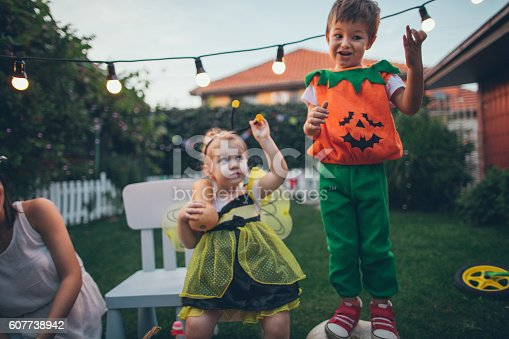 istock Costumed kids are ready for the Helloween night 607738942
