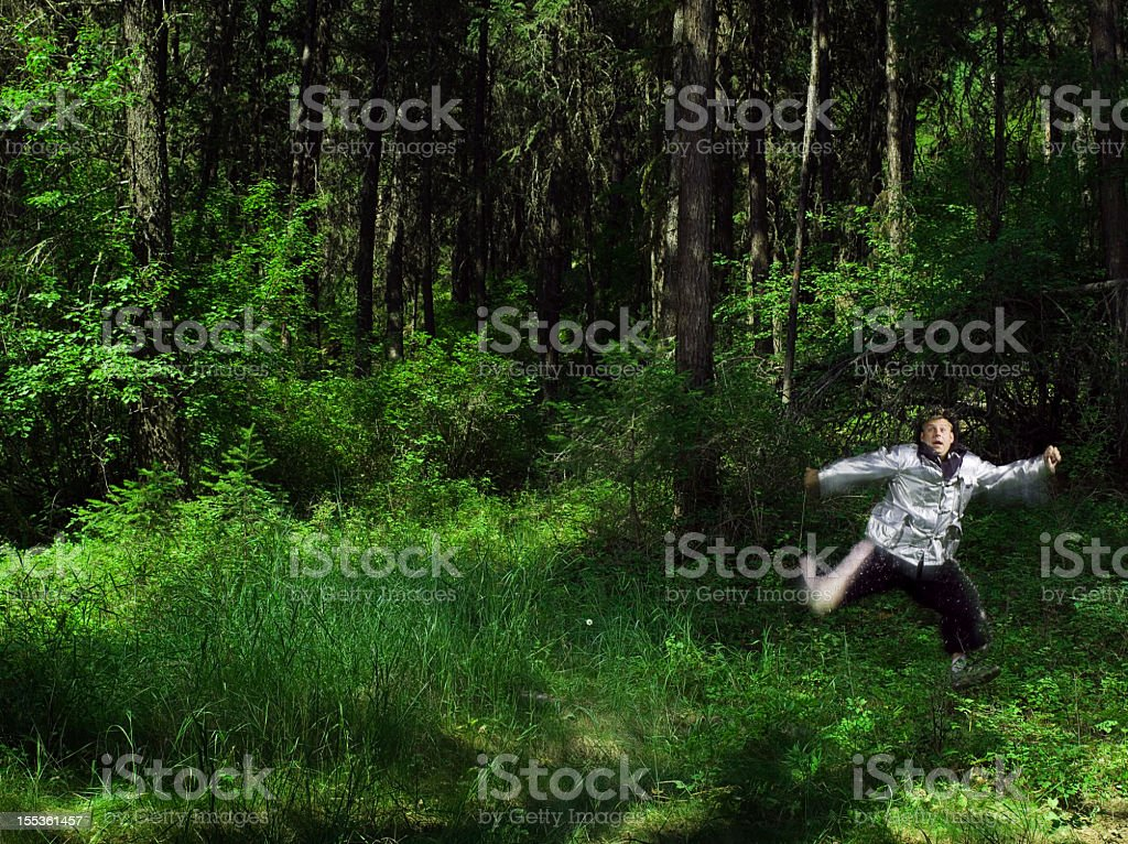Costumed Man Running Through Forest (Blurred Motion) stock photo