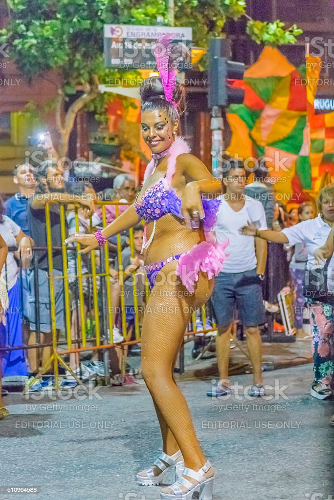 Costumed Woman Dancing Candombe at Carnival Parade of Uruguay stock photo