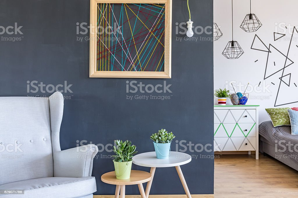 Cosy armchair and coffee tables stock photo