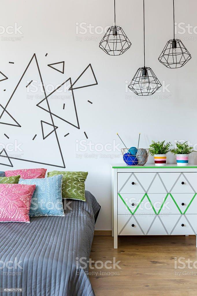Cosy bedroom with flowers stock photo
