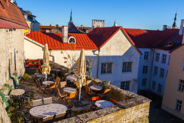 Cosy cafe on medieval wall of old town of Tallinn with beautiful cityscape with red roofs stock photo
