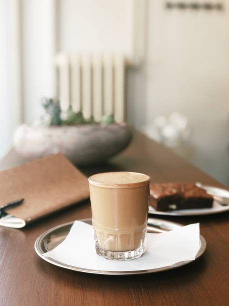 Cosy coffee table with cortado and brownie stock photo
