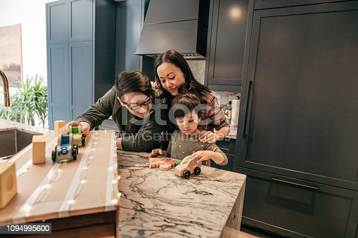 1082195070 istock photo Cosy family evening with kids and parents 1094995600