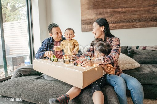 1082195070 istock photo Cosy family evening with kids and parents 1124551566
