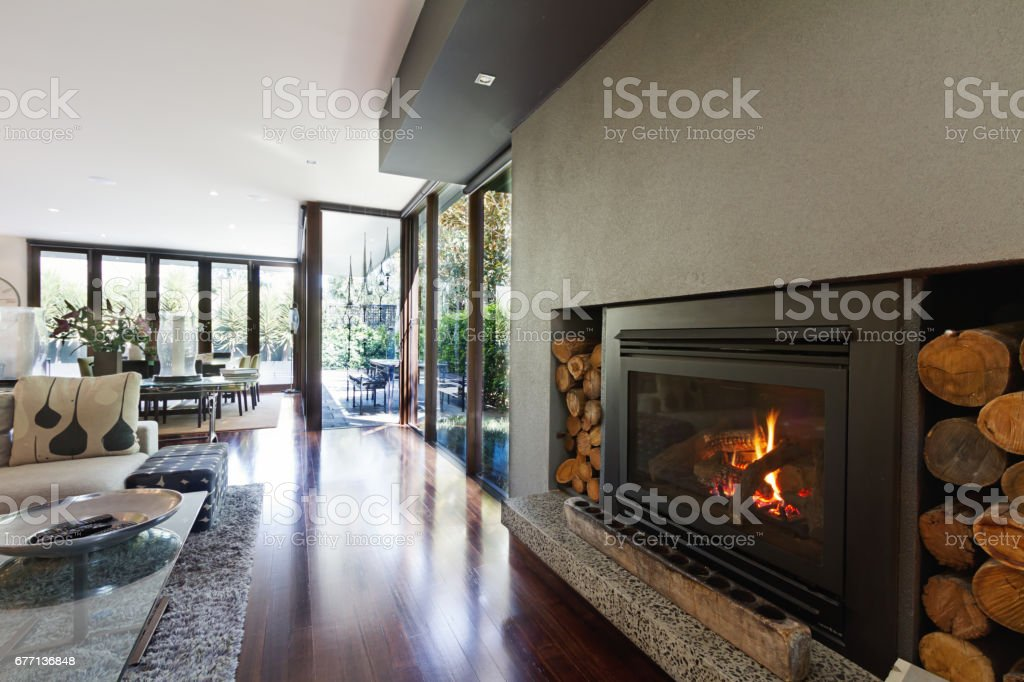 Cosy gas log fire in architect designed modern luxury open plan home stock photo