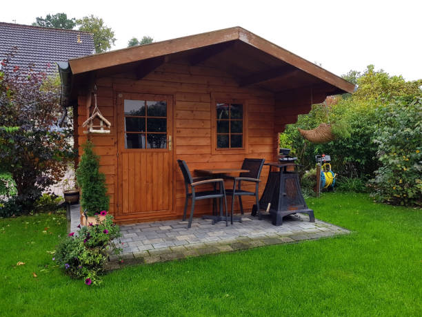 Cosy wooden garden shed Cosy wooden garden shed shed stock pictures, royalty-free photos & images