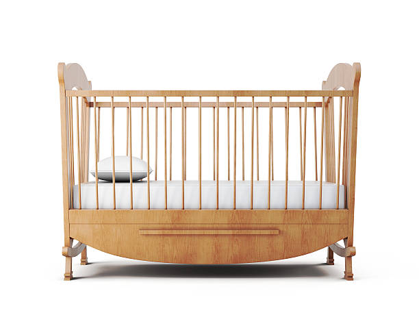 Cot bed isolated on white background. 3d rendering Cot bed isolated on white background. 3d rendering. crib stock pictures, royalty-free photos & images