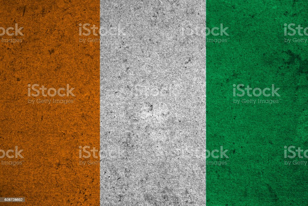 cote d ivoire flag on an old grunge background stock photo