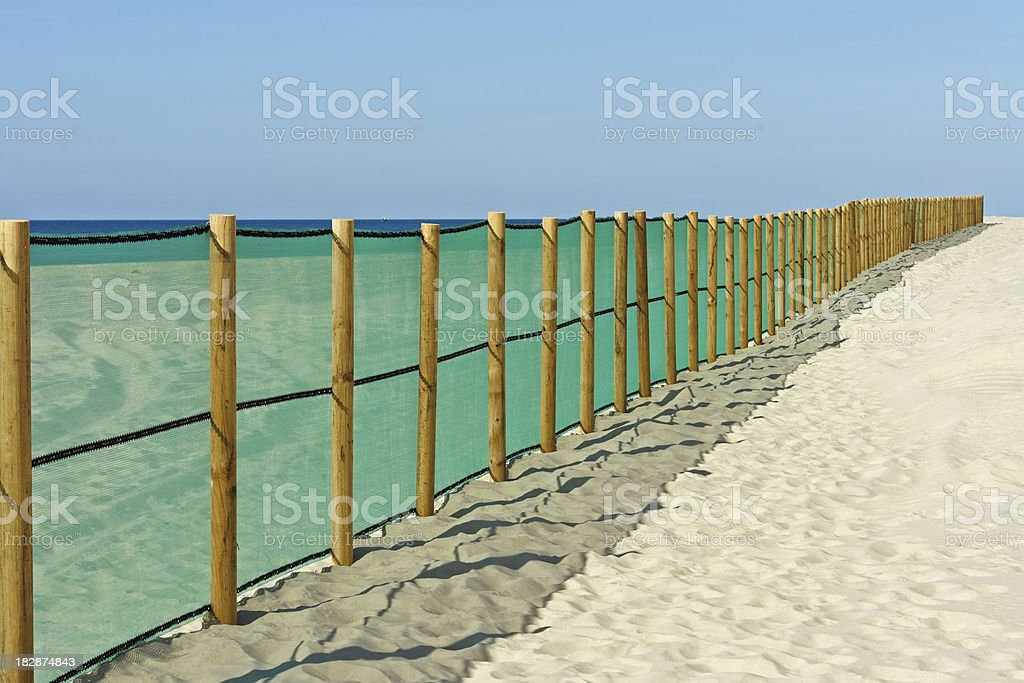 Cote d'Argent - Fence on the beach royalty-free stock photo