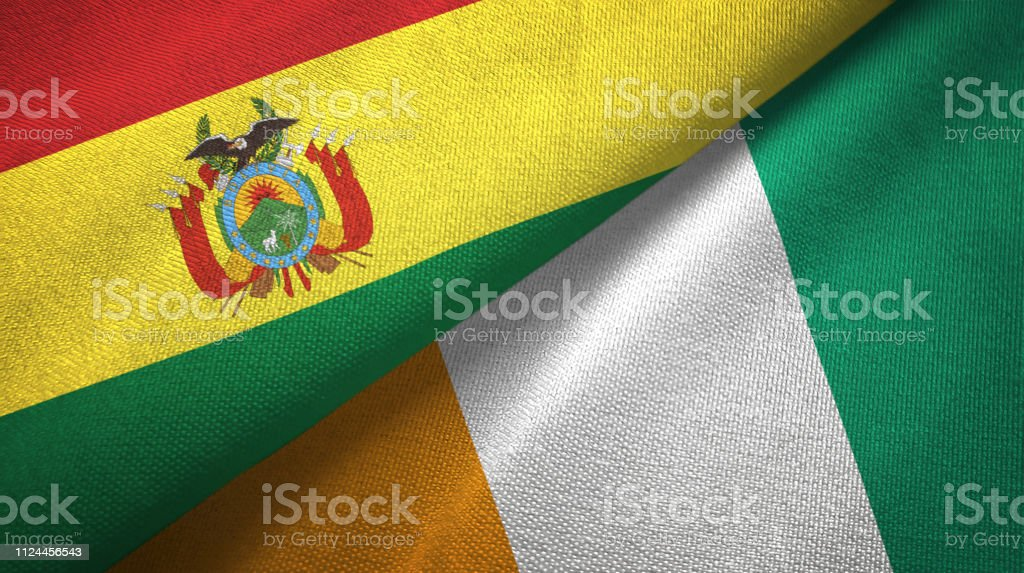 Cote d'Ivoire Ivory coast and Bolivia two flags together textile cloth, fabric texture stock photo