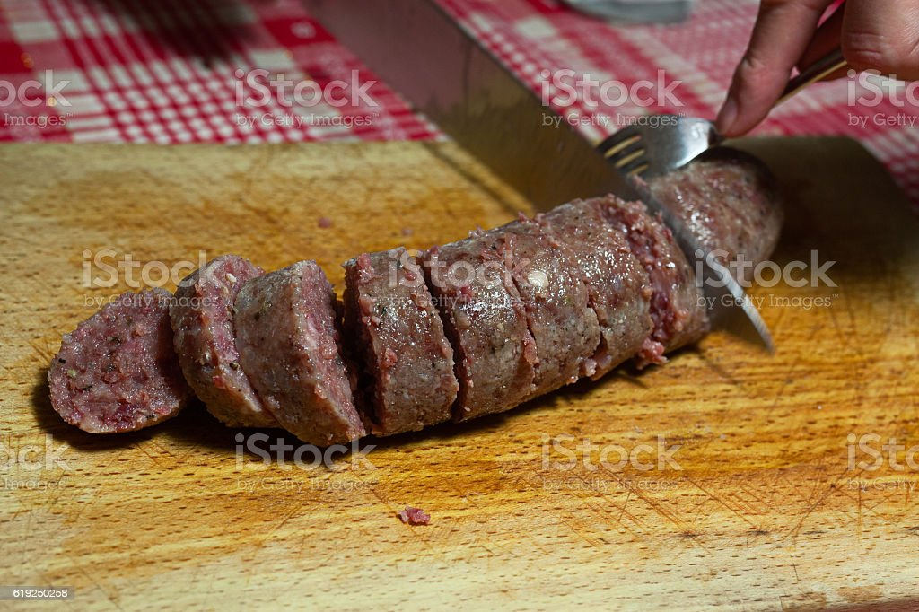 Cotechino slicing stock photo