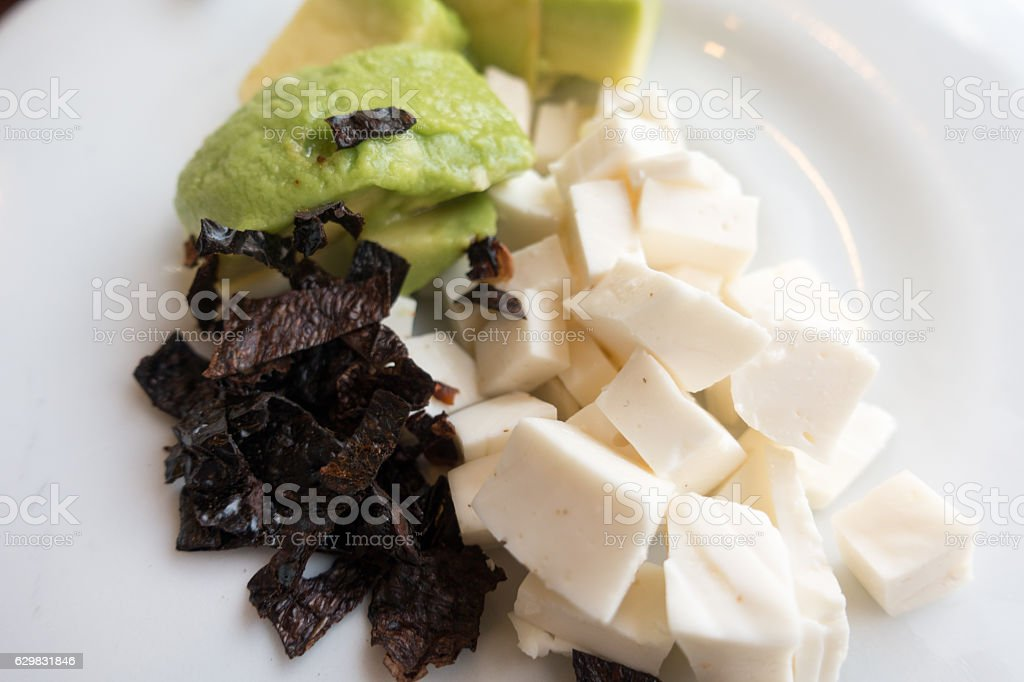 Cotija Cheese and Avocado Appetizer Plate at Mexican Restaurant stock photo