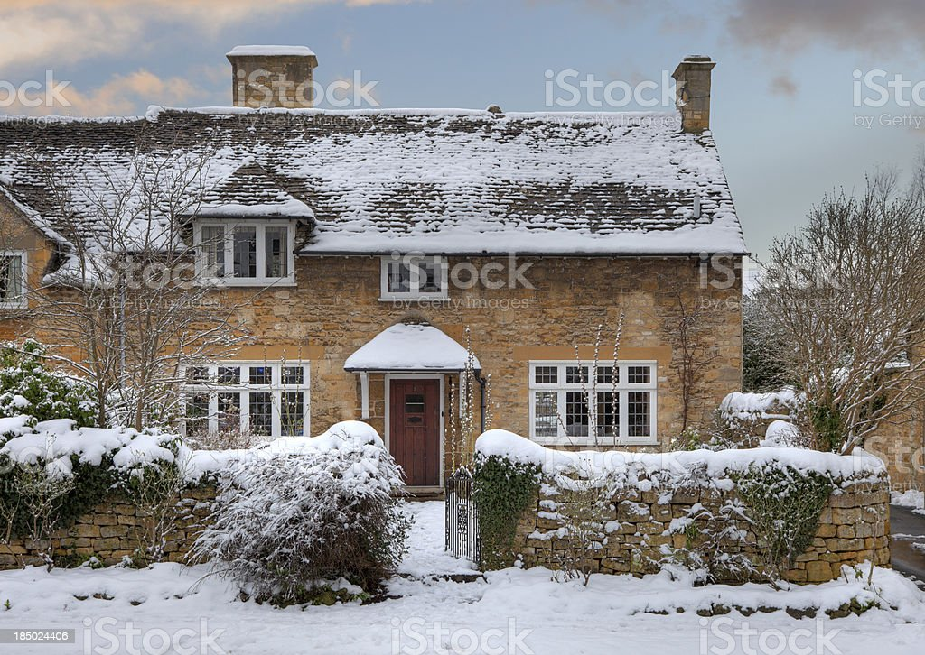Cotswold cottage in snow stock photo