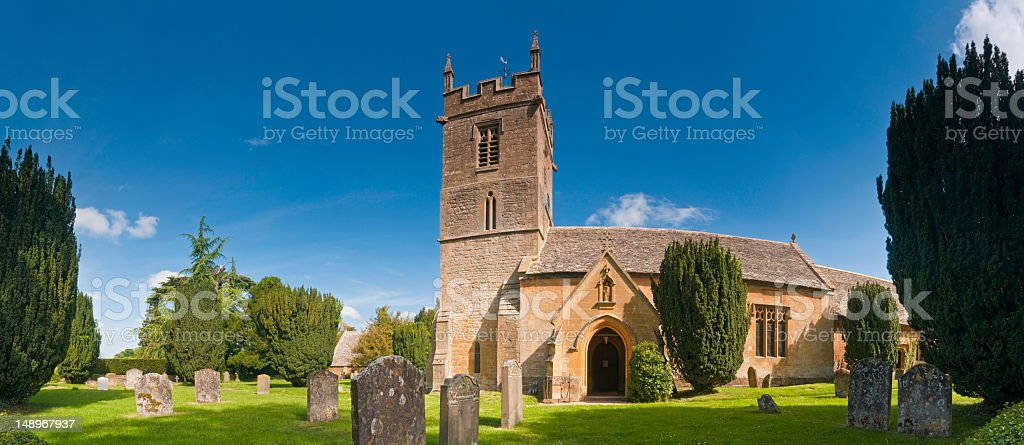 Cotswold country church summer skies royalty-free stock photo