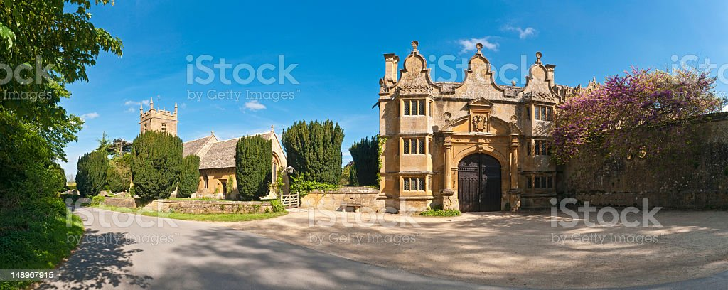 Cotswold gatehouse pretty churchyard quiet lane royalty-free stock photo