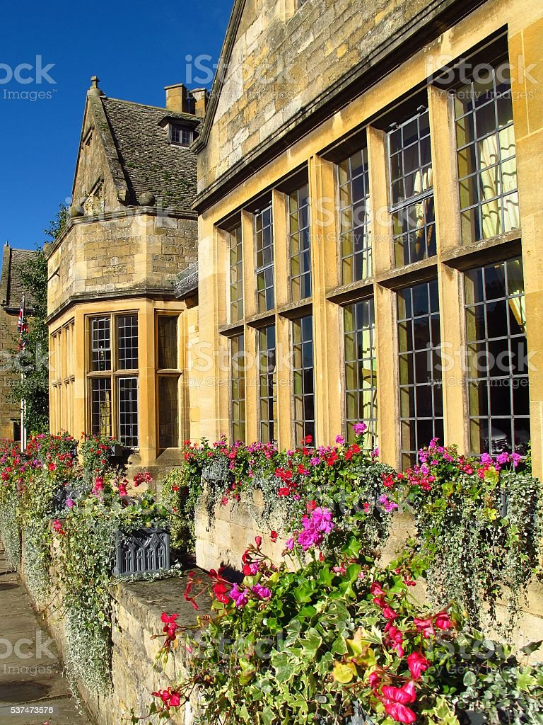 Cotswolds England Broadway village High Street flower boxes stock photo