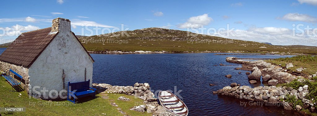 Cottage and boat in Connemara. Ireland stock photo