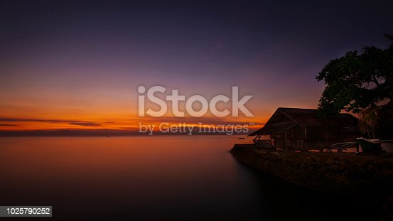 cottage by the sea romantic place in south of Cebu province blue hour capture wit long expose on a hot summer evening night