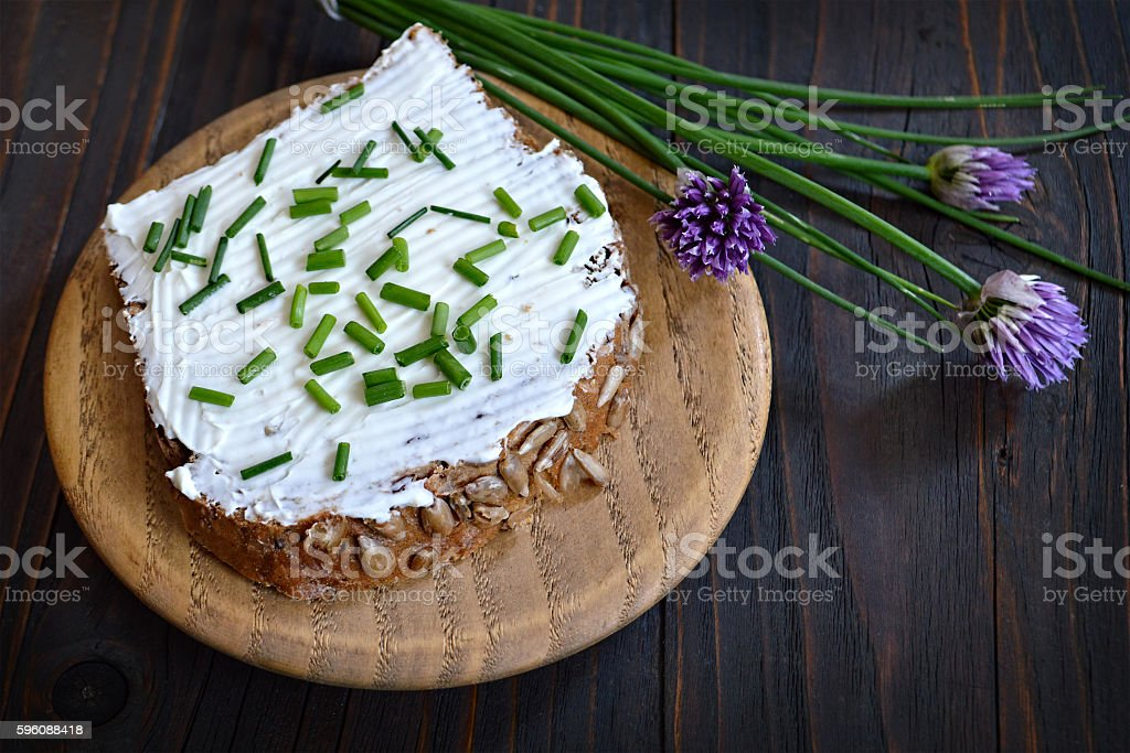 Cottage cheese and chives spread on slice of bread royalty-free stock photo