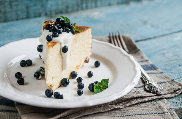 Cottage cheese baked pudding, sour cream and blueberries stock photo