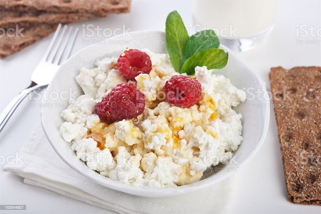 Cottage cheese breakfast with fresh raspberry royalty-free stock photo