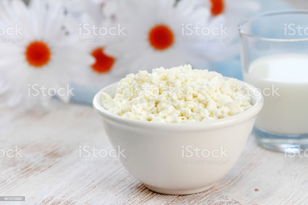 Cottage cheese in a bowl and glass of milk stock photo