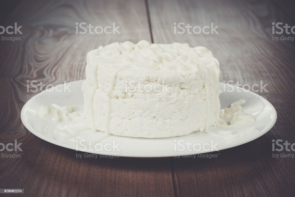 Cottage cheese on wooden table stock photo
