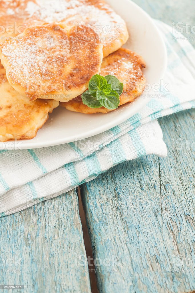 cottage cheese pancakes on a white plate royalty-free stock photo